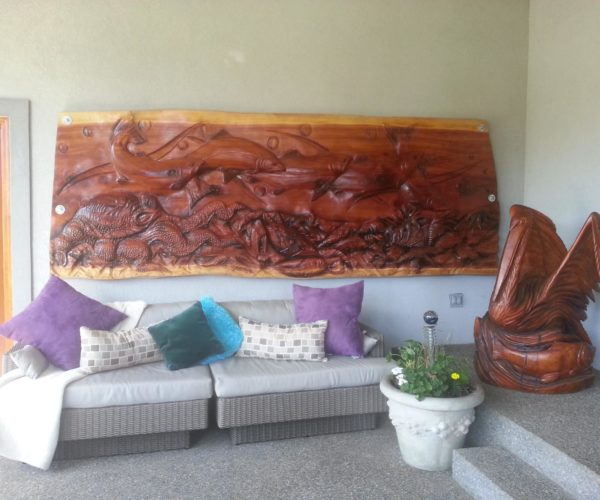wood sculpture hanging on wall