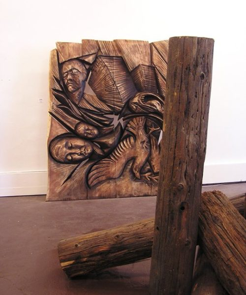 large wood sculpture in gallery